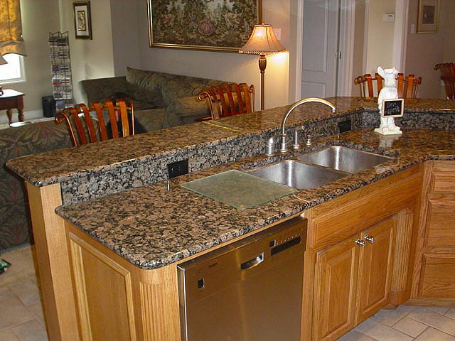 Tips for cleaning granite counter tops the maids blog Kitchen platform granite design