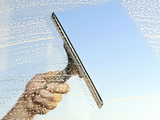 header - Cleaning windows with a squeegee